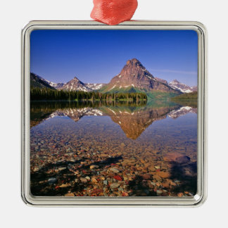 Mountains reflect into calm Two Medicine Lake in Metal Ornament