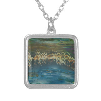 Mountains reflected in winter lake silver plated necklace