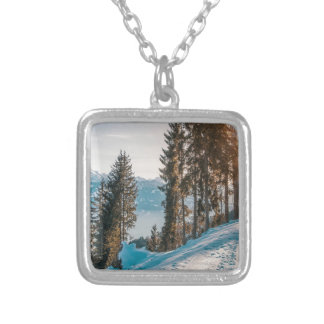 mountains trees and snow silver plated necklace