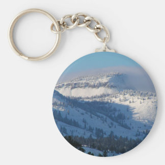 Mountains with blowing snow basic round button keychain