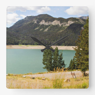 Mountains with water view wall clock
