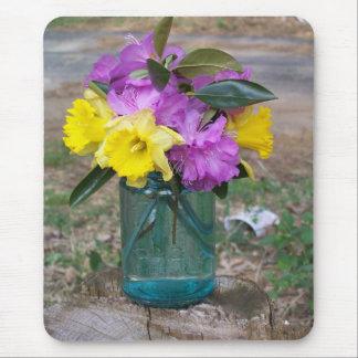 mousepad bouquet of flowers in a blue jar
