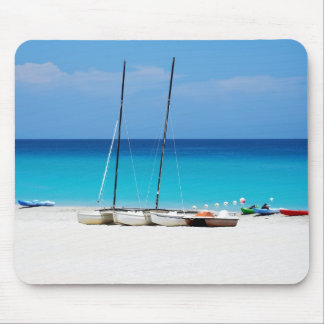 Mousepads with a picture of boats on a beach