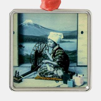 Mt. Fuji on a Silk Screen Behind Spinning Geisha Metal Ornament