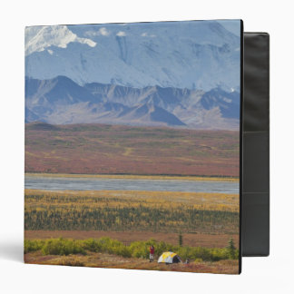 Mt. McKinley towers behind a camper and his tent 2 Vinyl Binders