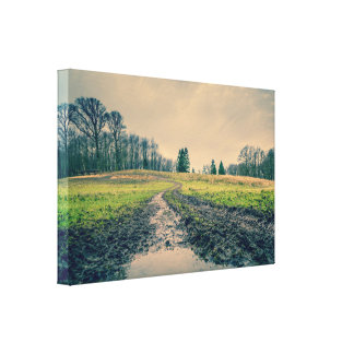Muddy road in an autumn scenery canvas print