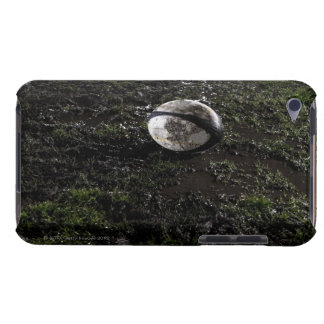 Muddy rugby ball sitting on a chewed up grass barely there iPod covers