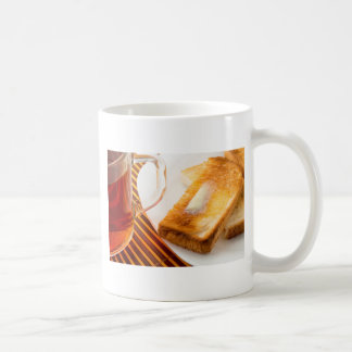 Mug of tea and hot toast with butter