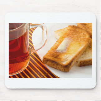 Mug of tea and hot toast with butter mouse pad