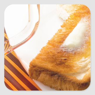Mug of tea and hot toast with butter square sticker