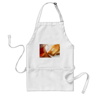 Mug of tea and hot toast with butter standard apron