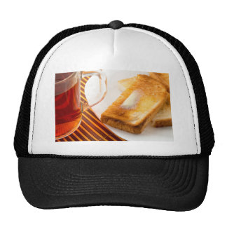 Mug of tea and hot toast with butter trucker hat