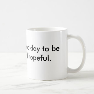 Mug saying be friendly & hopeful.