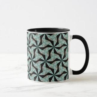 Mug with green geometric abstract pattern on a bla