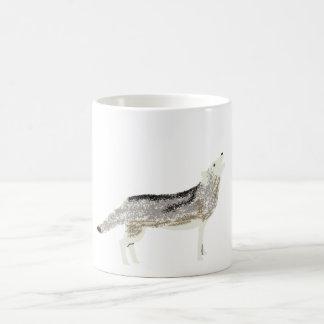 Mug with howling wolf.