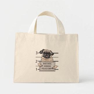 mugshot dog cartoon. mini tote bag