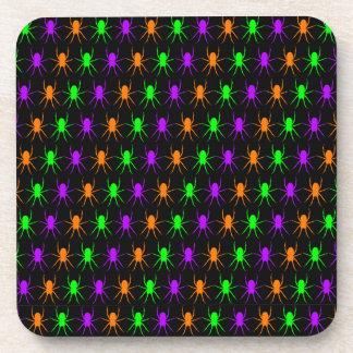 Multi bright spiders on black coasters
