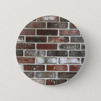 Multi color brick wall with reds, whites and brown 2 inch round button