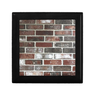 Multi color brick wall with reds, whites and brown gift box