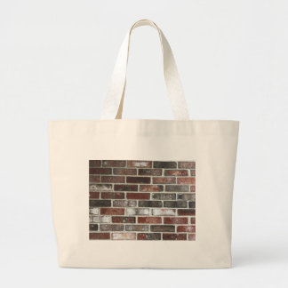 Multi color brick wall with reds, whites and brown large tote bag