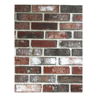 Multi color brick wall with reds, whites and brown letterhead