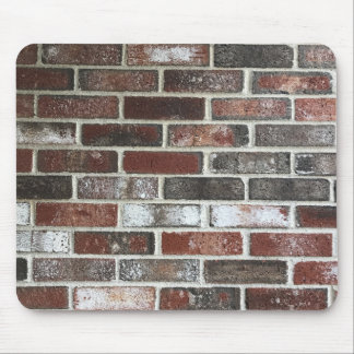 Multi color brick wall with reds, whites and brown mouse pad