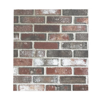 Multi color brick wall with reds, whites and brown notepad