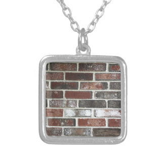 Multi color brick wall with reds, whites and brown silver plated necklace