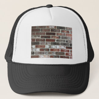 Multi color brick wall with reds, whites and brown trucker hat