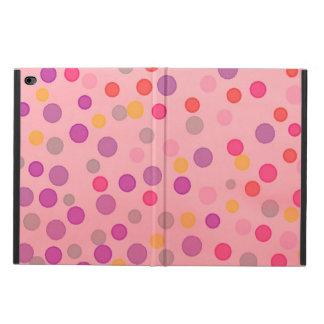 Multicolor confetti dots on pink