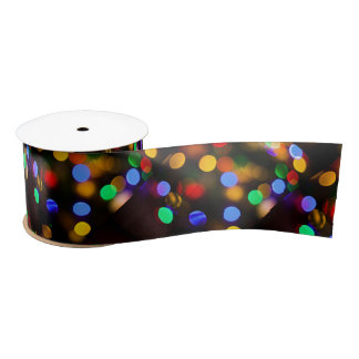 Multicolored Christmas lights. Satin Ribbon