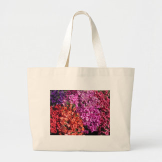 Multicolored petunia flowers texture background large tote bag
