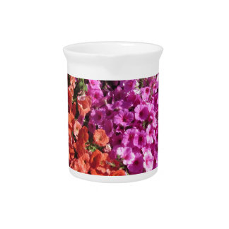 Multicolored petunia flowers texture background pitcher