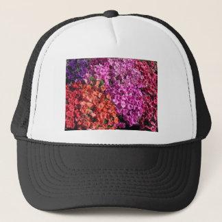 Multicolored petunia flowers texture background trucker hat