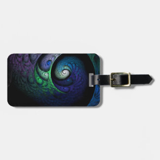 Multicolored spiral fractal picture on the dark luggage tag