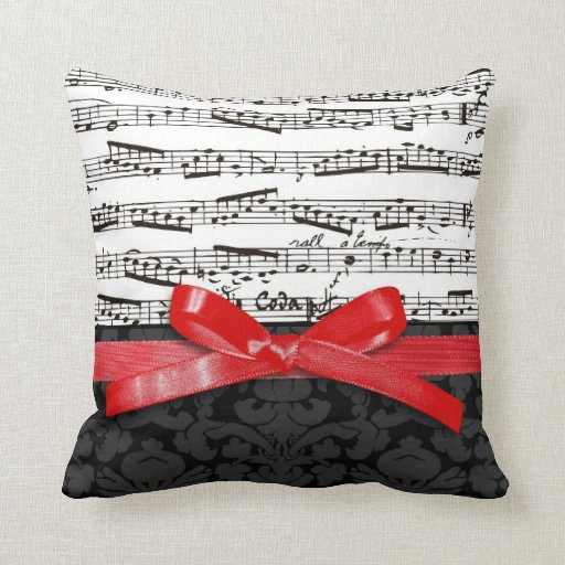Music notes and faux red ribbon pillows