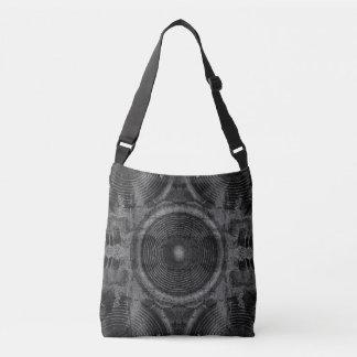 Music speaker on a cracked wall crossbody bag