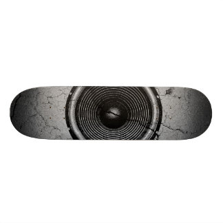 Music speaker on a cracked wall skate board deck