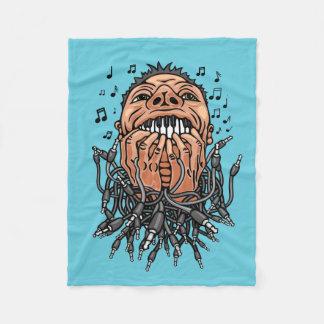 musician plays on his teeth like on keyboard fleece blanket