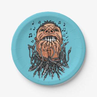 musician plays on his teeth like on keyboard paper plate