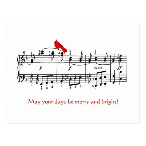 Musique et carte postale rouge cardinale de Noël
