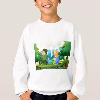 Muslim boy and girl in the park sweatshirt