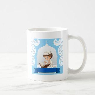 Muslim boy praying at the church coffee mug