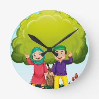 Muslim couple in the park wallclocks