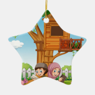 Muslim couple reading books in the park ceramic star ornament