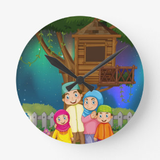 Muslim family in the garden at night wall clock