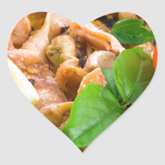 Mussels, squid and octopus, decorated with greens, heart sticker