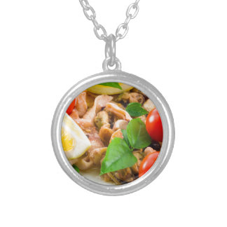 Mussels, squid and octopus, decorated with greens, silver plated necklace