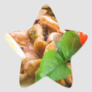 Mussels, squid and octopus, decorated with greens, star sticker