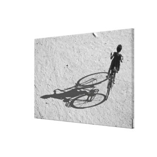 Myamar, Bagan, Young boy riding a huge bike and Canvas Print